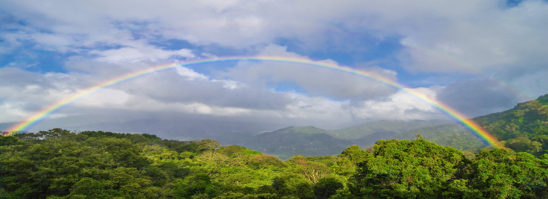 double_rainbow_clouds_and_tropical_forest_background_in_boquete_panama